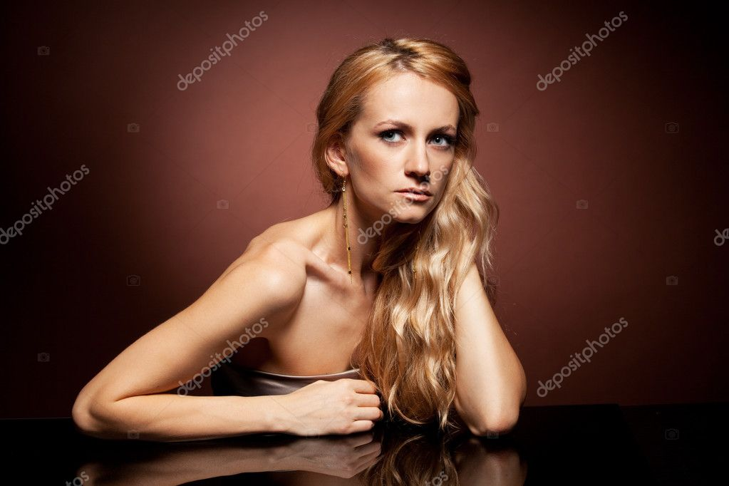 Fashion portrait of  young woman with long hair on brown background  Stock Photo #5987066