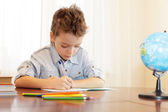 Boy does house lessons — Stock Photo