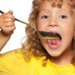 Child with spoon — Stock Photo #6282986