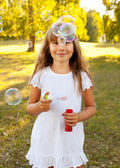 Girl with bubbles — Stock Photo