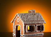 Gingerbread house on white — Stock Photo