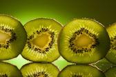 Green Kiwi in row — Stock Photo