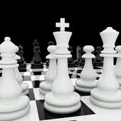 Chess pieces on a chess board — Stockfoto