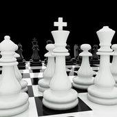 Schaakstukken op een schaakbord — Stockfoto