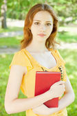 Girl-student with a book — Stock Photo