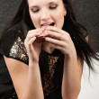 Woman bites off sandwich - Foto Stock