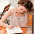 Stock Photo: Girl with pen outdoors