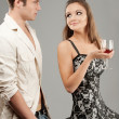 Beautiful woman drinks wine and man - Stock Photo