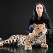 Mature woman and spotty leopard — Foto Stock #5477538