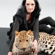 Mature woman and spotty leopard - Stock Photo