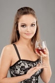Beautiful woman drinks wine — Stock Photo