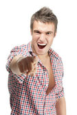 Cheerful malicious young man — Stock Photo