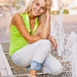 Girl about fountain - Stock Photo