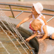 Sisters play at fountain — Stock Photo #5494457