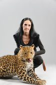 Mature woman and spotty leopard — Stock Photo