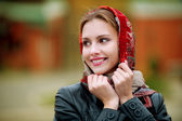 Young beautiful woman in a red scarf — Stock Photo