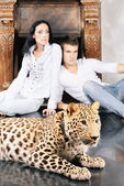 Mature woman and young man with spotty leopard — Stock Photo