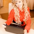 Woman-student works on black laptop — Stockfoto #5556591