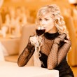 Young woman drink red wine — Stock Photo