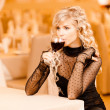 Young woman drink red wine - Stock Photo