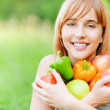 Beautiful girl with apples and sweet pepper — Stock Photo