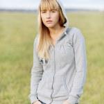 Beautiful girl in jacket with hood — Stock Photo #5657187