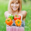 Beautiful girl with sweet pepper — Stock Photo