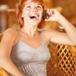 Stock Photo: Woman talks by mobile phone