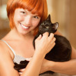 Woman with black cat. — Stock Photo