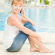 Smiling woman i with phone — Stock Photo