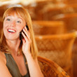 Woman talks by mobile phone — Stock Photo
