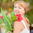 Woman with flowers — Stock Photo #5674124