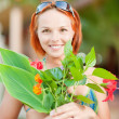 Woman with flowers — Stock Photo #5674138