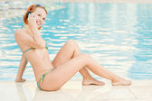 Smiling woman in bikini in pool — Stock Photo