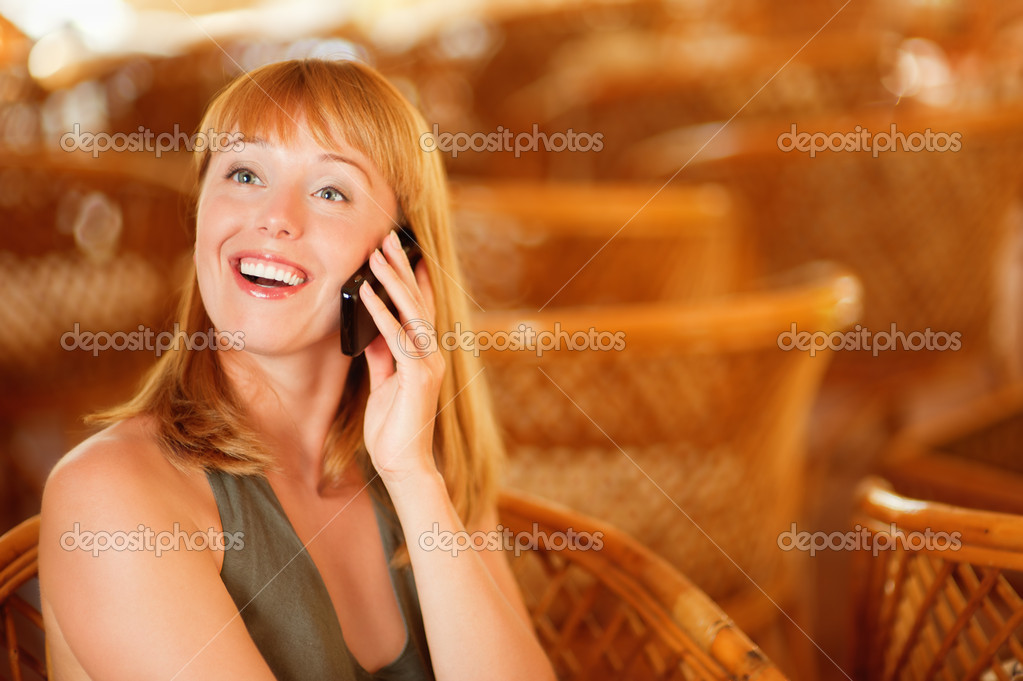 Beautiful laughing woman talks by mobile phone. — Stock Photo #5674120