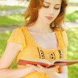 Long-haired girl reads book — Stock Photo #5681767