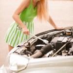 Car mechanician repairs engine — Stock Photo #5769285
