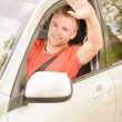 Driver of car waves hand — Stock Photo