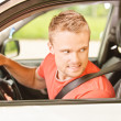Driver of car looks back — Stock Photo #5769291