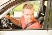 Driver of car looks back — Stock Photo