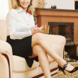 Business woman sits on sofa — Stock Photo