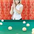 Woman plays billiards — Stock Photo