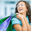 Woman with purchases from shop - Stock Photo