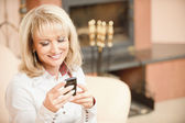 Woman reading sms on phone — Stock Photo