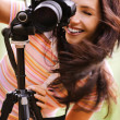 Beautiful girl with camera — Stock Photo #5844277