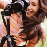 Beautiful girl with camera — Stock Photo #5844277