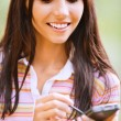 Young nice woman with PDA — Stockfoto
