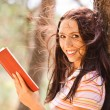 Lovely young woman reads book — Stock Photo #5844280