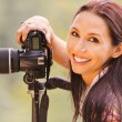 Beautiful girl with camera — Stockfoto