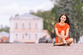 Young charming woman in red dress — Stock Photo